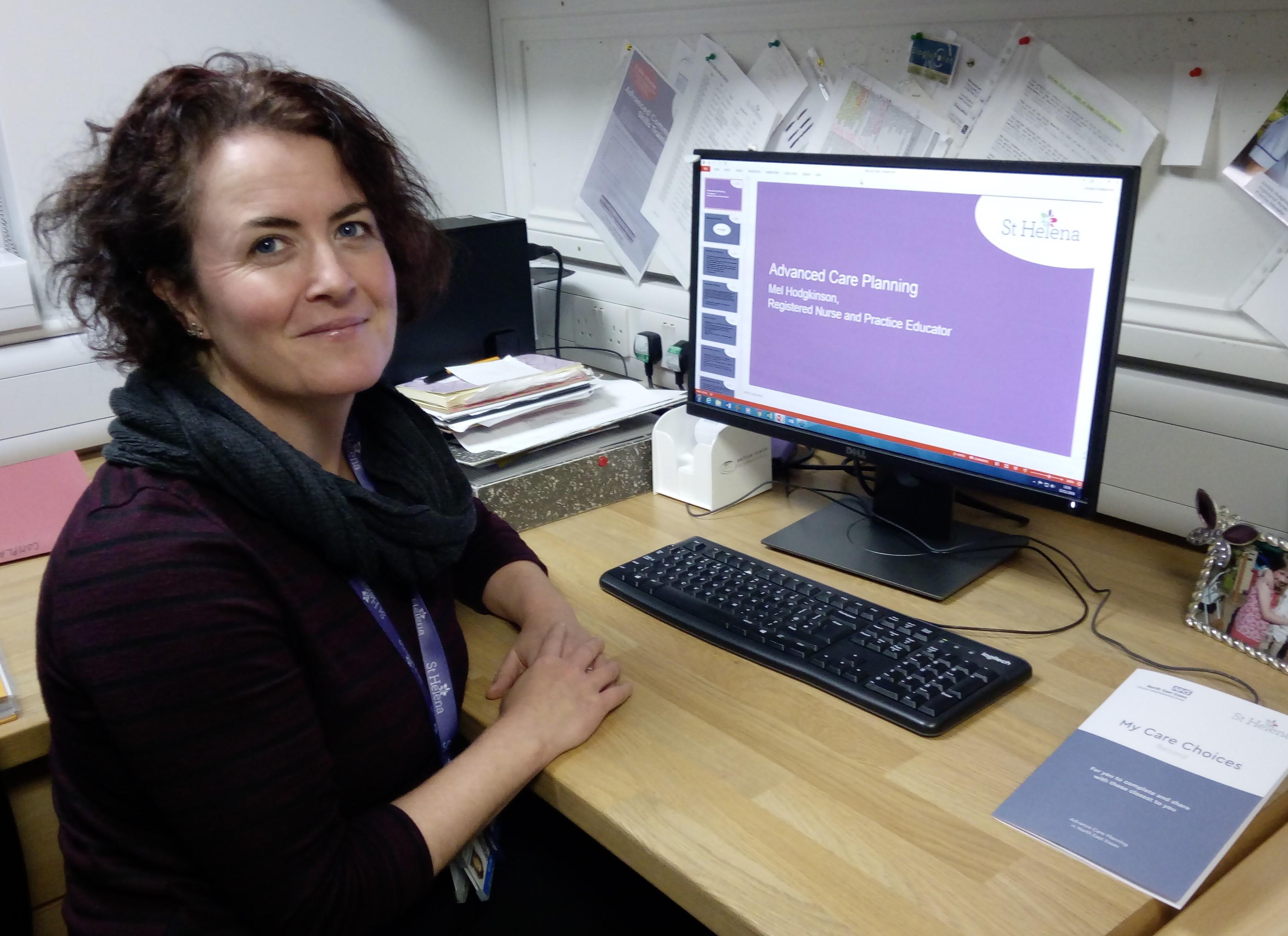 Mel at her desk